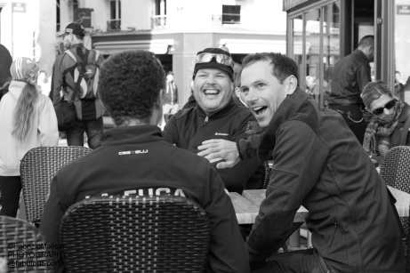 Cycling friends having good time at a café