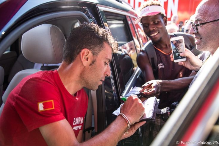 Vincenzo Nibali of Cycling Team Bahrain Merida signing autographs to fans in Ivrea