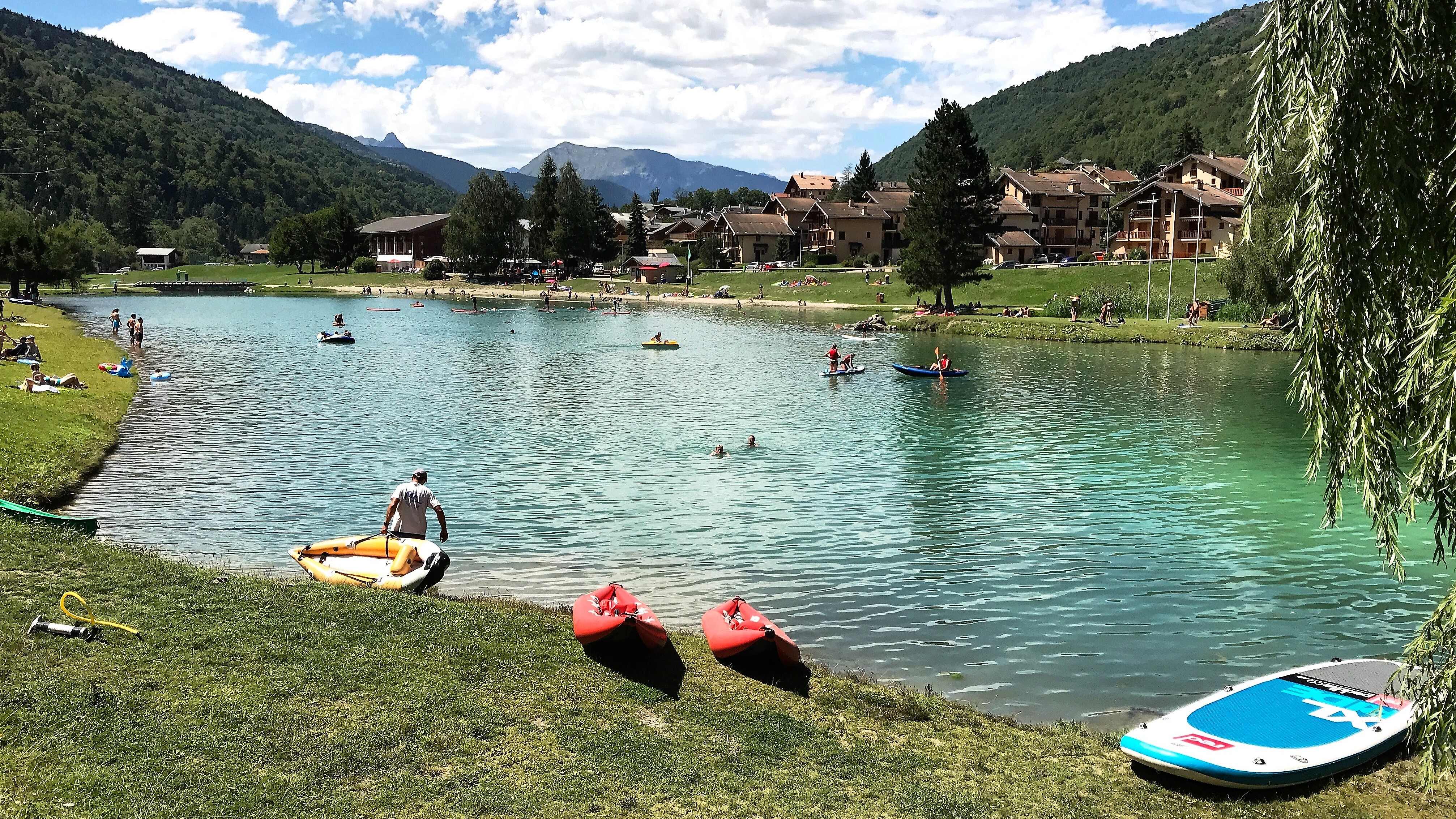 Bozel Plage - The lake of the mountain village of Bozel in the Tarentaise, Rhone Alpes, Savoie region of France. Fabulous Outdoors